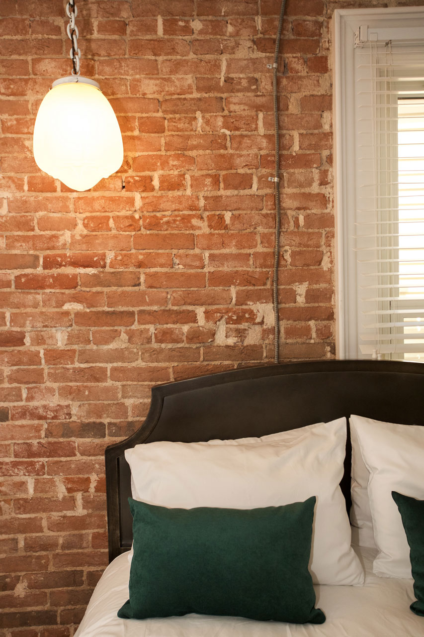 exposed brick wall in hotel room