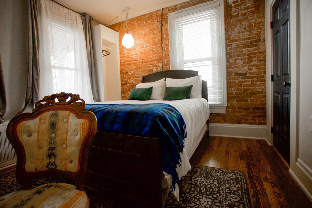 Exposed brick wall hotel room at the dove inn