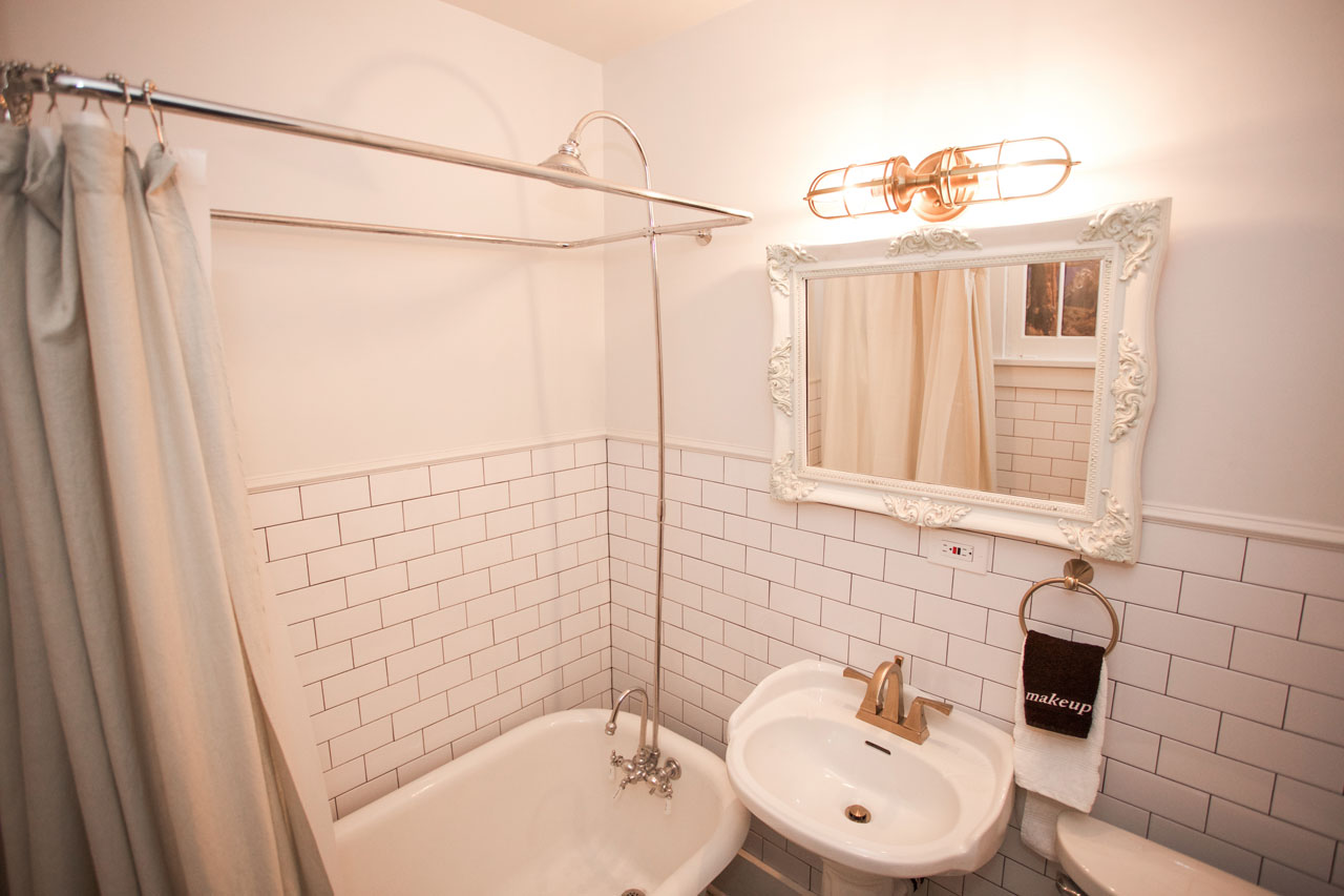 subway tile hotel bathroom with large tub and shower